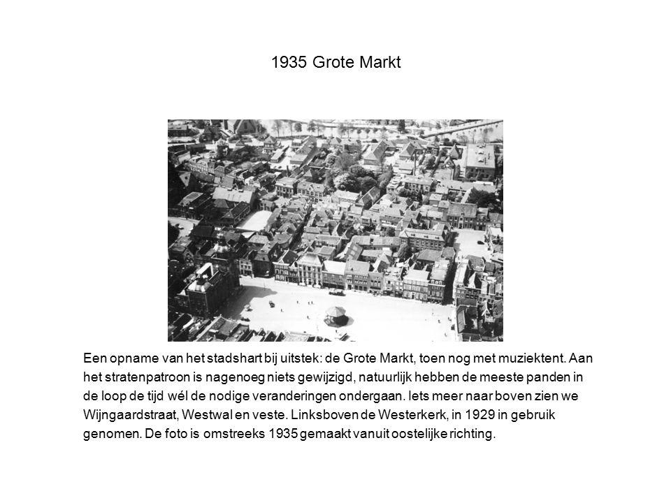 1935 Grote Markt Een opname van het stadshart bij uitstek: de Grote Markt, toen nog met muziektent. Aan.
