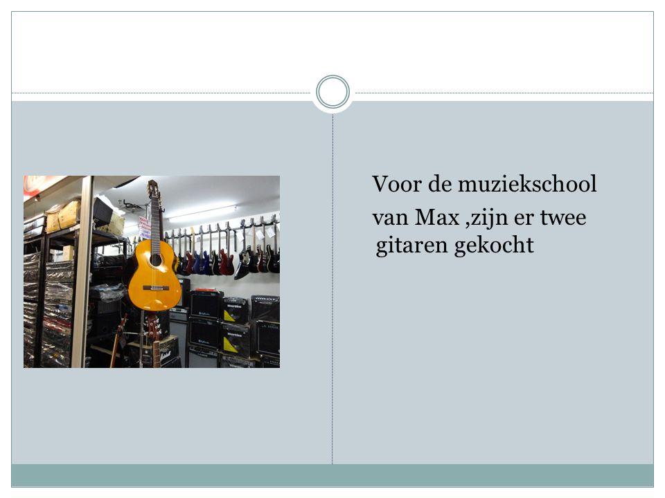 Voor de muziekschool van Max ,zijn er twee gitaren gekocht