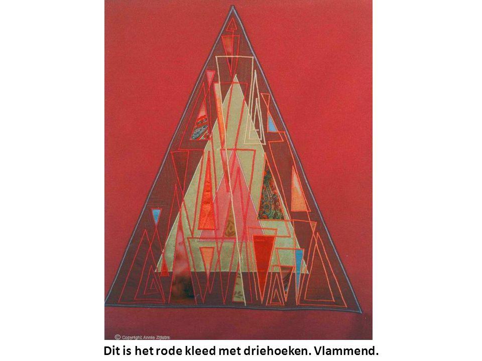 Dit is het rode kleed met driehoeken. Vlammend.
