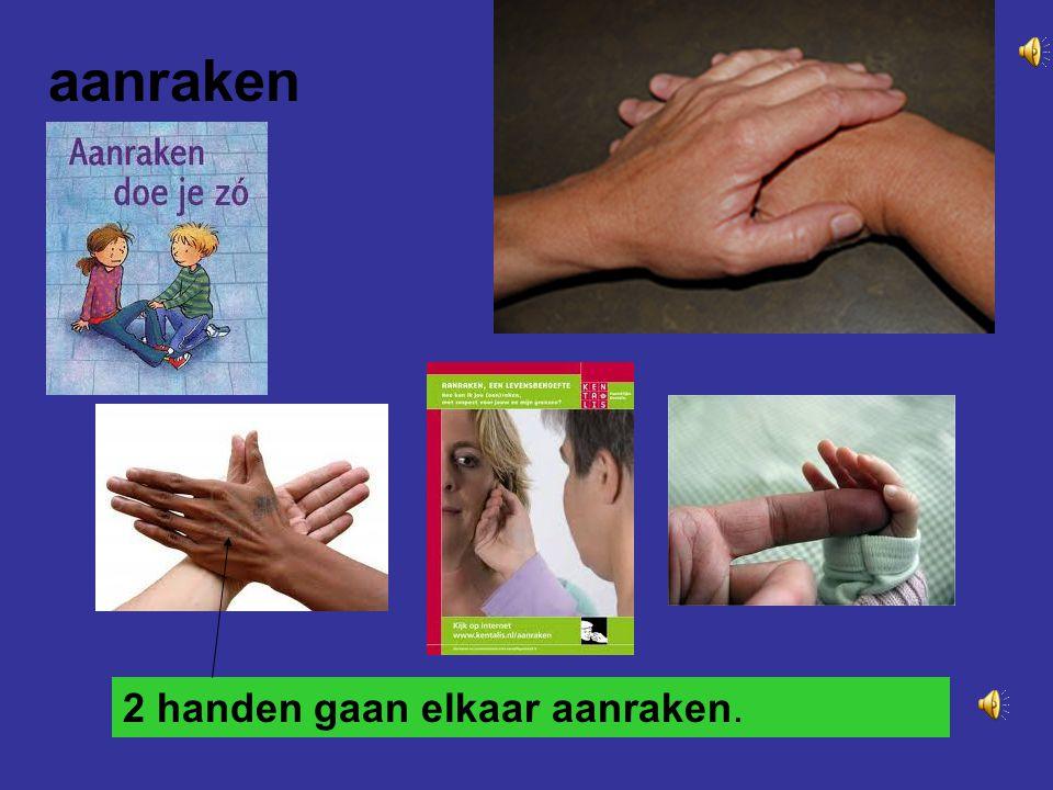 aanraken 2 handen gaan elkaar aanraken.
