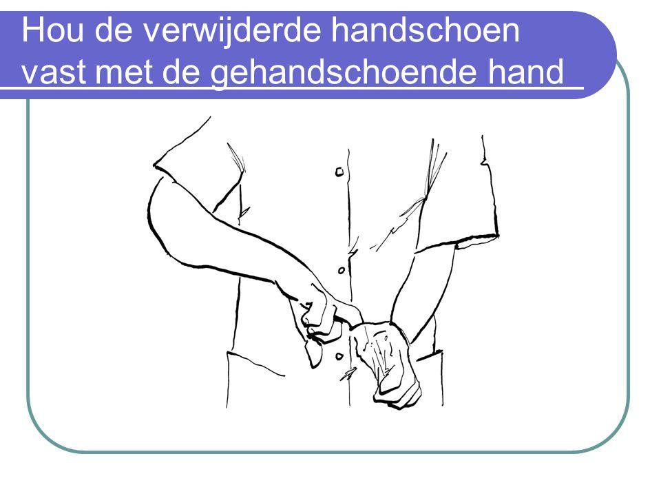 Hou de verwijderde handschoen vast met de gehandschoende hand