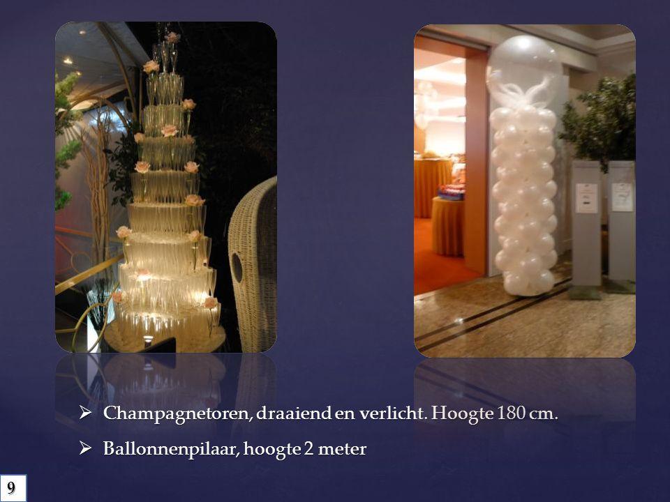 Champagnetoren, draaiend en verlicht. Hoogte 180 cm.