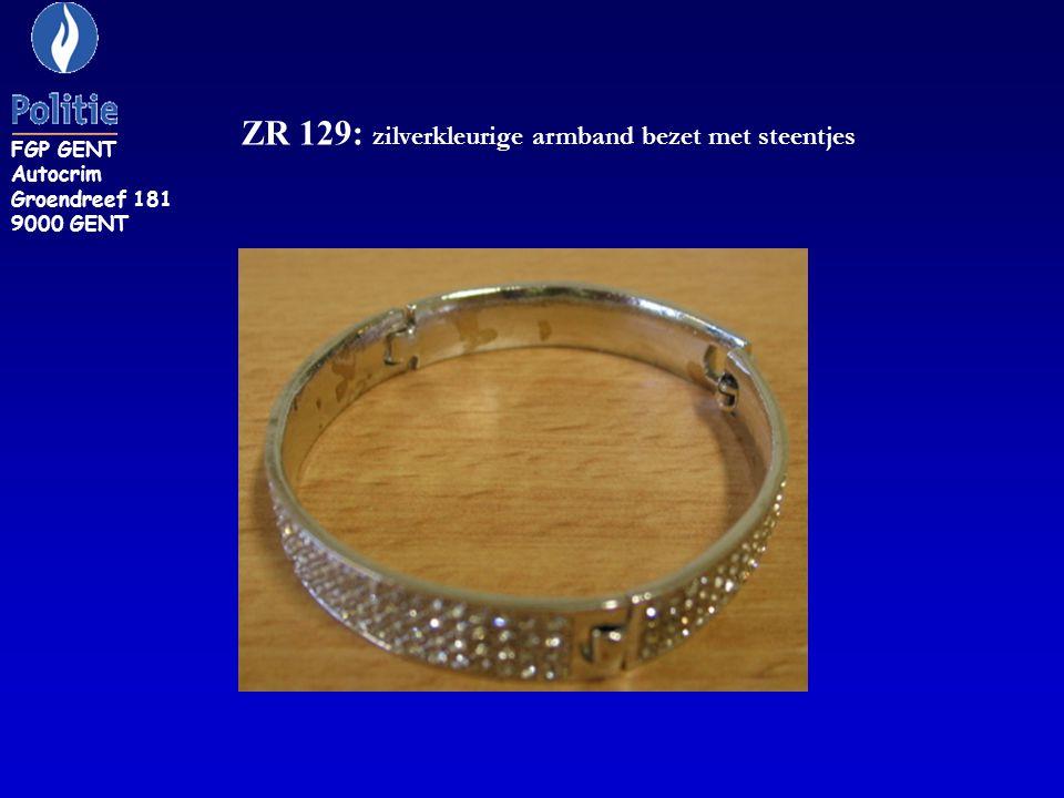 ZR 129: zilverkleurige armband bezet met steentjes