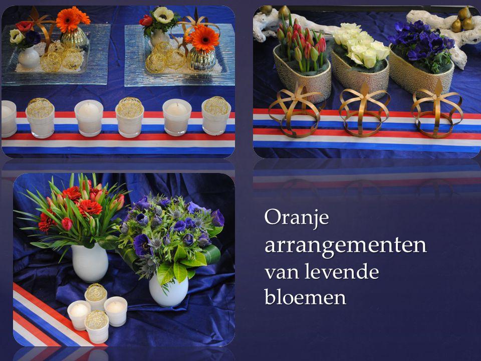 Oranje arrangementen van levende bloemen