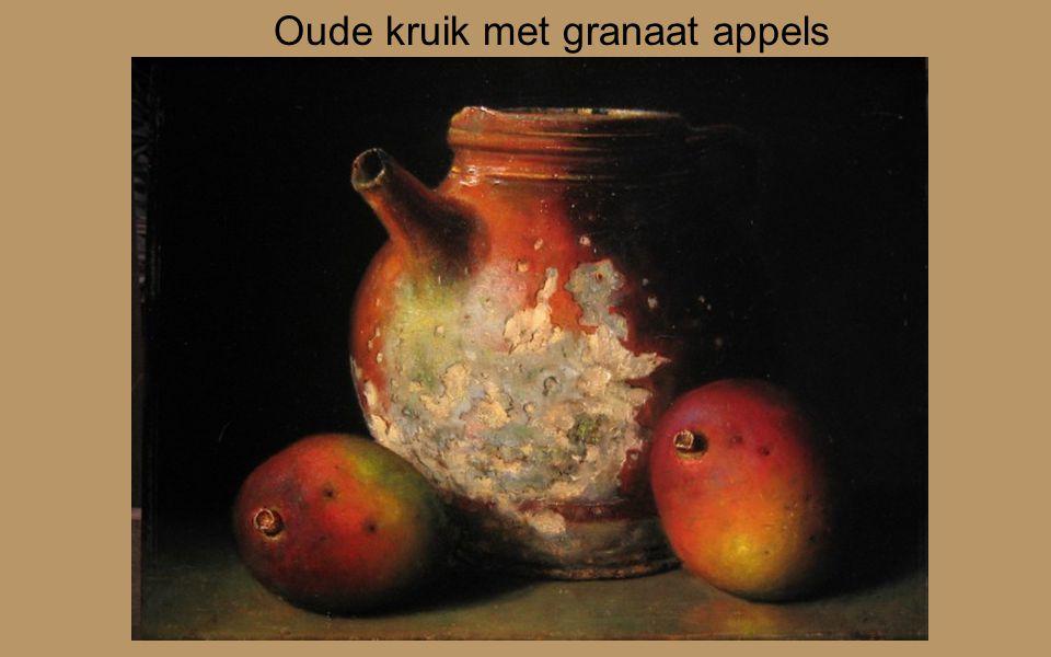Oude kruik met granaat appels