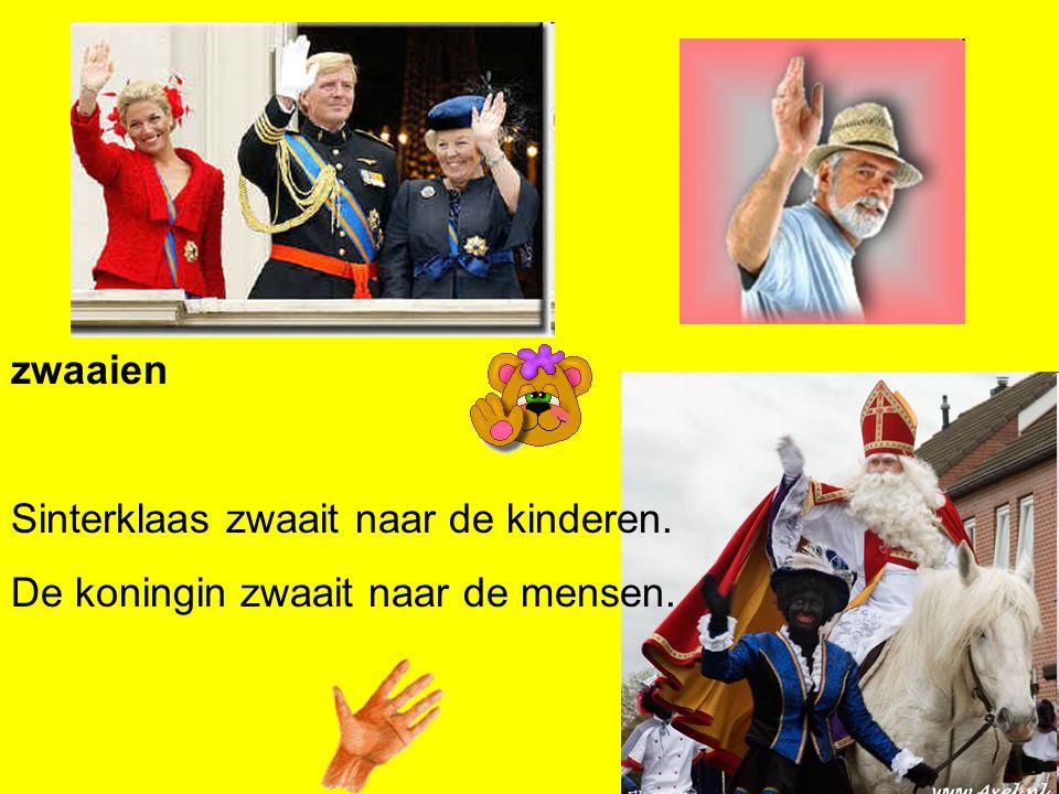 zwaaien Sinterklaas zwaait naar de kinderen. De koningin zwaait naar de mensen.