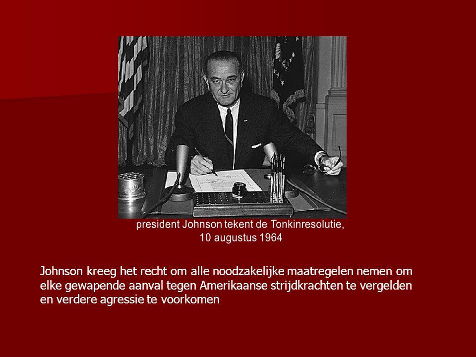 president Johnson tekent de Tonkinresolutie,
