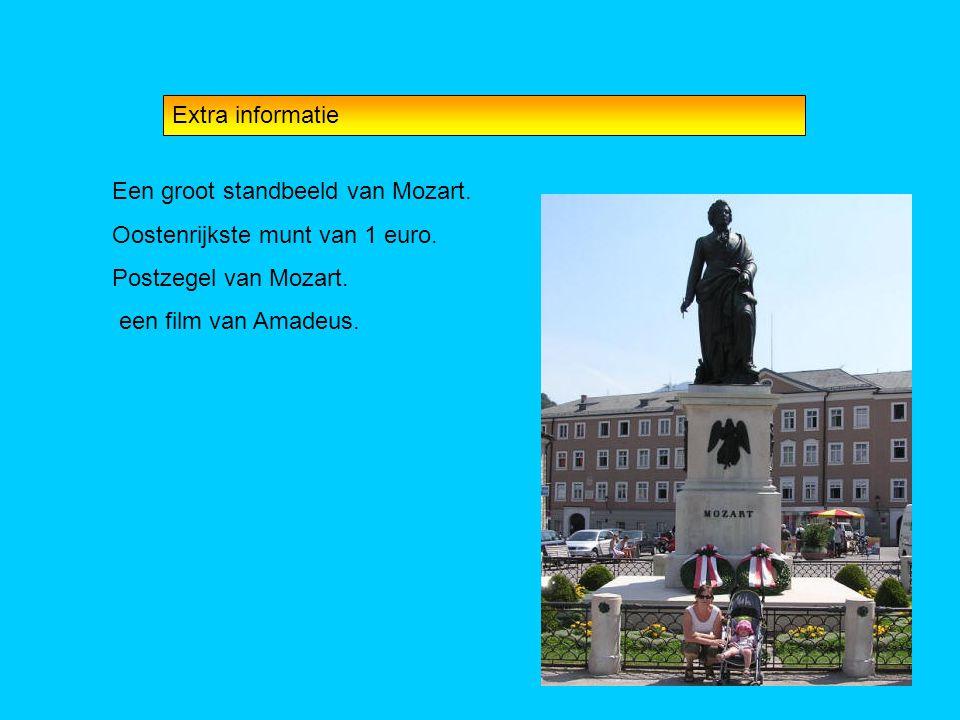 Extra informatie Een groot standbeeld van Mozart. Oostenrijkste munt van 1 euro. Postzegel van Mozart.