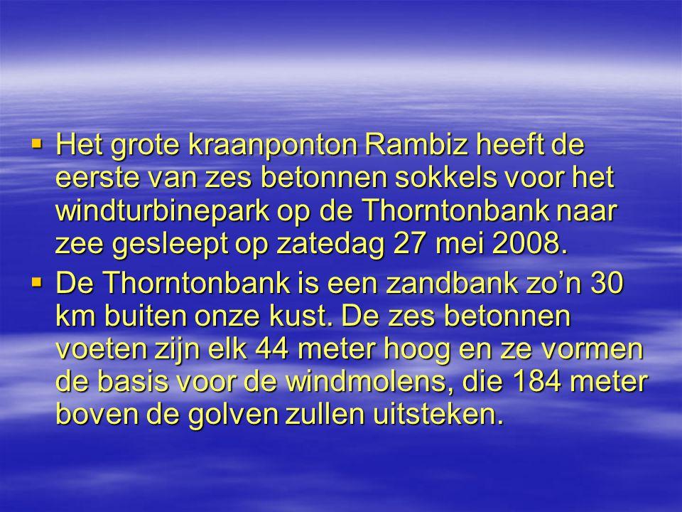 Het grote kraanponton Rambiz heeft de eerste van zes betonnen sokkels voor het windturbinepark op de Thorntonbank naar zee gesleept op zatedag 27 mei 2008.