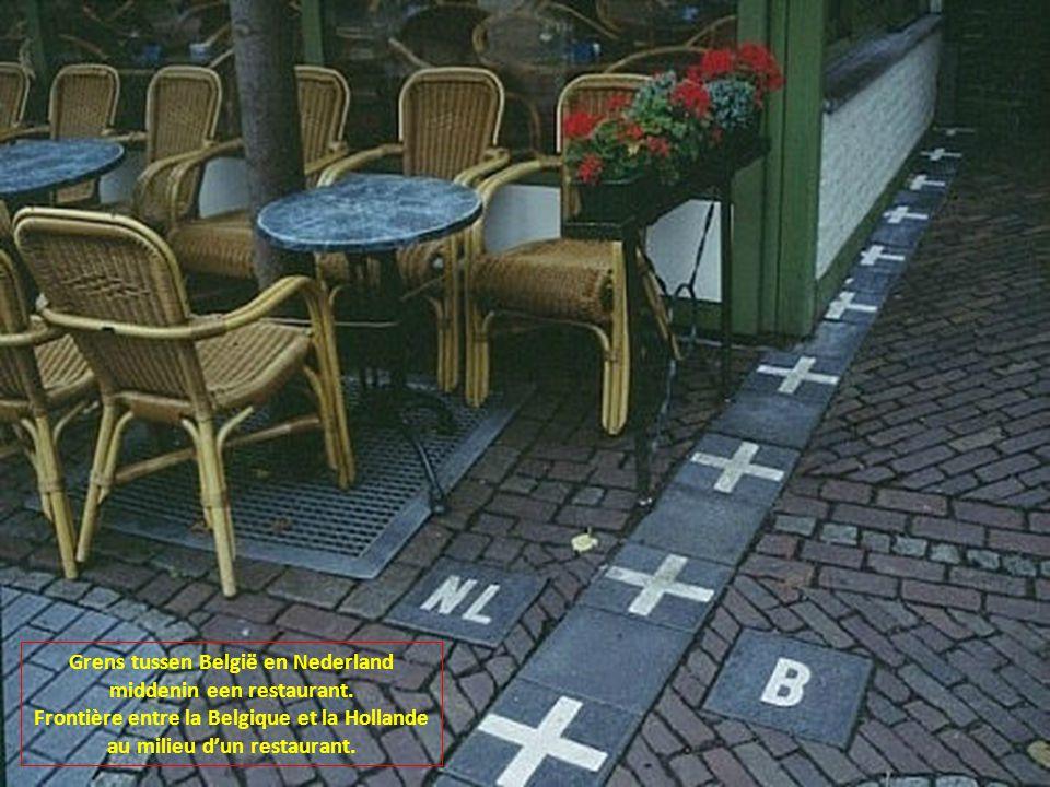 Grens tussen België en Nederland middenin een restaurant.