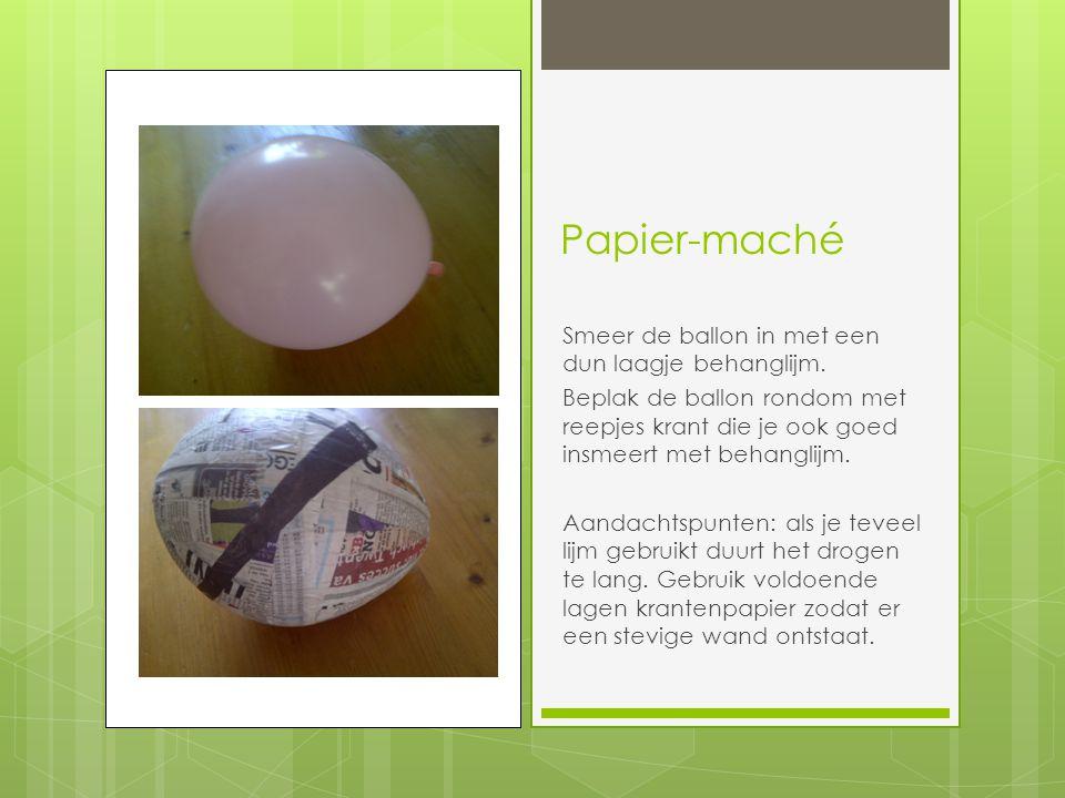 Papier-maché Smeer de ballon in met een dun laagje behanglijm.