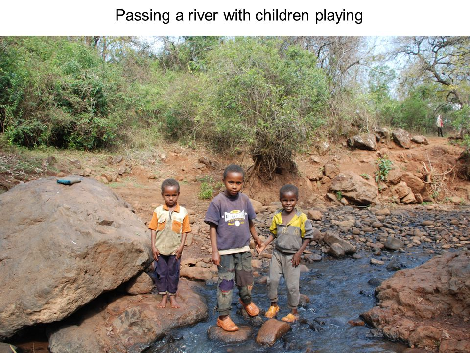Passing a river with children playing